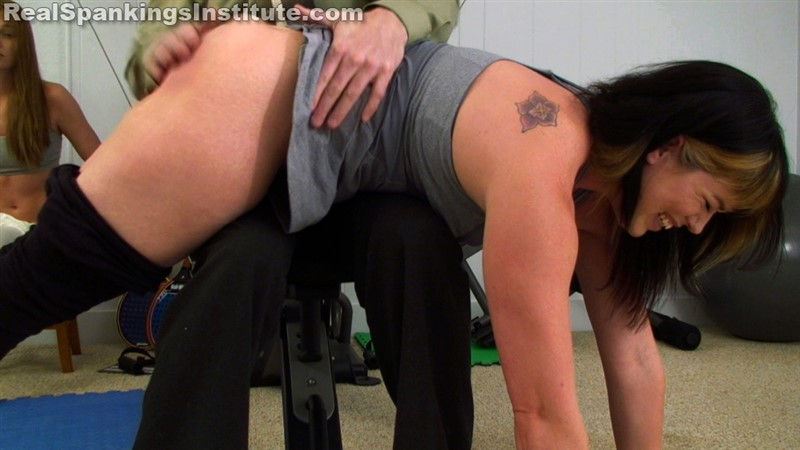 [realspankingsinstitute] - Betty in scene: Alyssa and Betty Spanked OTK (Part 2 of 2) - Classroom - HD/MP4 - image1