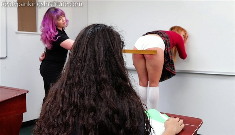 The Center Of Attention Receives The Ruler - realspankingsinstitute - Full HD/MP4 - image1
